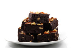Brownies isolated on white plate Stock Photos