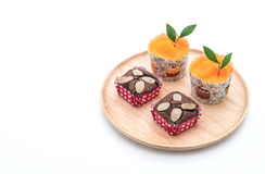 Brownies and orange cup cake. On white background royalty free stock images