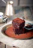 Brownies with raspberry on a wooden background. Royalty Free Stock Images