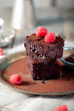 Brownies with raspberry on a wooden background. Brownies with fresh raspberry  on a wooden background Royalty Free Stock Photos