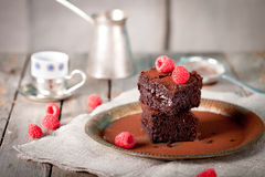 Brownies with raspberry on a wooden background. Brownies with fresh raspberry  on a wooden background Stock Photography