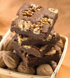 Brownies. Stack of brownies with walnuts Royalty Free Stock Image