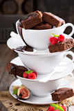 Brownies in stacked coffee cups with chocolate sauce Stock Images