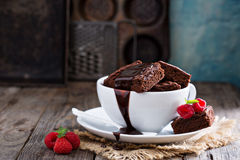 Brownies in stacked coffee cups with chocolate sauce Stock Image