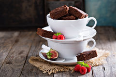 Brownies in stacked coffee cups with chocolate sauce Stock Photos