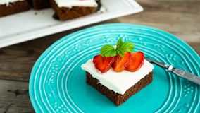 Brownies with strawberry on a plate Royalty Free Stock Photography