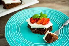 Brownies with strawberry on a plate Stock Images
