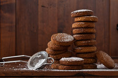 Brownies tower of whole wheat flour, oats and hazelnuts with strainer for icing sugar Royalty Free Stock Images