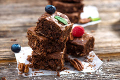 Brownies on wooden background Stock Photography