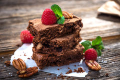 Brownies on wooden background Stock Images
