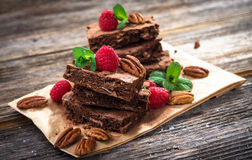 Brownies on wooden background Stock Photos
