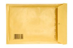 Brownish Envelope. Back view of a brown air-cushioned envelope with an imprinted bar code. Isolated on a white background Stock Image
