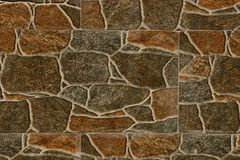 Brownish gray stone texture from a fragment of the basement with large cobblestones Royalty Free Stock Photography