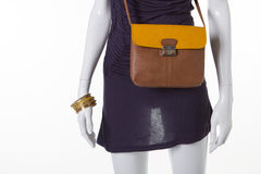 Brownish-yellow leather bag on a mannequin. Royalty Free Stock Photography
