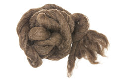 Brownpiece of Australian sheep wool Merino breed close-up on a white background Royalty Free Stock Photography