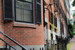 Brownstone apartments on city street Royalty Free Stock Image
