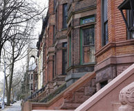Brownstone Brooklyn, Park Slope row houses. View of 19th century row houses in Park Slope neighborhood of Brooklyn with church steeple in backgrounbd Royalty Free Stock Photo