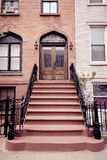 Brownstone Entrance with Gate. A brownstone entrance in Hoboken, New Jersey Royalty Free Stock Images