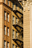 Brownstone fire escape. In between two buildings in downtown boston massachusetts on a sunny day Royalty Free Stock Images