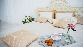 Browse Large Bed With Pillows and Bright Bedroom White Walls. royalty free stock photos