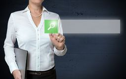 Browser touchscreen is shown by businesswoman.  royalty free stock image