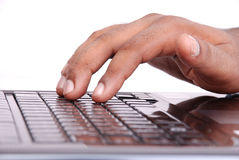 Browsing. Hand on laptop isolated background Royalty Free Stock Photography
