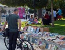 Browsing books for sale in park at Piata Universitatii, Buchares Stock Image