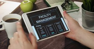Browsing facility management web page using digital tablet stock footage