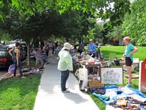 Browsing the Flea Market. Photo of people at a flea market on 6/3/17 in a a washington dc neighborhood. They are shopping for bargains from sellers who want to Royalty Free Stock Images