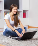 Browsing Internet Young Woman Using Laptop Royalty Free Stock Photography