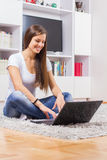 Browsing Internet Young Woman Using Laptop Royalty Free Stock Images