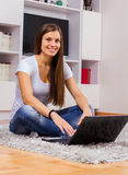 Browsing Internet Young Woman Using Laptop Royalty Free Stock Photo