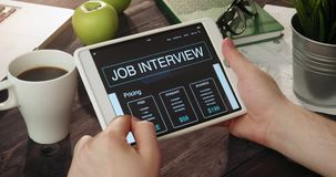 Browsing job interview info using digital tablet stock video