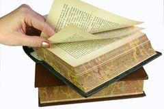 Browsing the pages. Hand turning and browsing pages in old book Royalty Free Stock Images