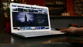 Browsing photo of London in Google. MAR 19, 2017, MOSCOW, RUSSIA: Browsing photo of London in Google - man using Laptop planning travel, time lapse Royalty Free Stock Photos