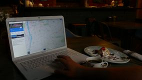 Browsing photo of Prague in Google - man using Laptop planning travel