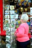 Browsing post cards. Stock Photos