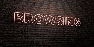 BROWSING -Realistic Neon Sign on Brick Wall background - 3D rendered royalty free stock image. Can be used for online banner ads and direct mailers Royalty Free Stock Images
