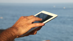 Browsing tablet Next to the Seashore Panoramic Stock Image