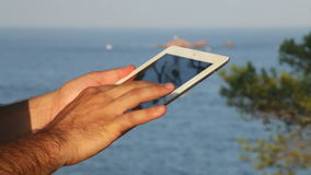 Browsing tablet Next to the Seashore Rack Focus stock video