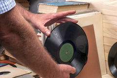 Browsing through vinyl records collection. Music background. Copy space Royalty Free Stock Photography