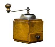 Broyeur de café en bois de vintage sur un fond blanc Photographie stock libre de droits