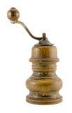 Broyeur de poivre en bois antique isoalted sur le blanc Photographie stock libre de droits