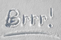 Brrr!  It is cold outside!. The word Brrr is written in the snow by a child Stock Images