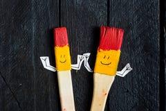 2 brsushes искусства с стороной улыбки Стоковое фото RF