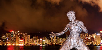 Bruce Lee and night of HK stock images