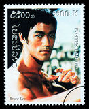 Bruce Lee Postage Stamp. LAOS - CIRCA 1999: A postage stamp printed in Laos showing Bruce Lee, circa 1999 Stock Images