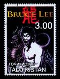 Bruce Lee Postage Stamp. TADJIKISTAN - CIRCA 2000: A postage stamp printed in Tadjikistan showing Bruce Lee, circa 2000 Stock Photo