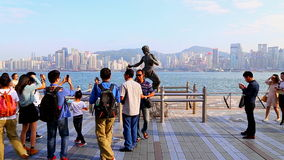 Bruce lee statue in hong kong. Tourists gathered around the 2.5 meter bronze statue of legendary kung fu movie star bruce lee at the avenue of stars attraction stock video