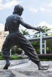 Bruce Lee staty som lokaliseras i Hong Kong Arkivbild